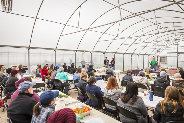Listening to Kate Payne inside the (relative) warmth of the greenhouse.  Photo by Scott David Gordon